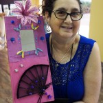Renee with her mirror. Her flower has a clip to attach special photos.