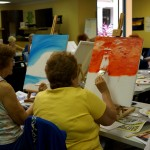 group at work painting